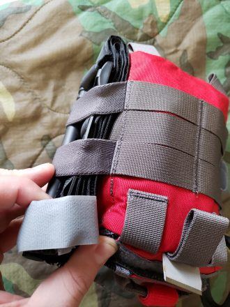 A photo of the FATpack's external elastic catching on a tourniquet.